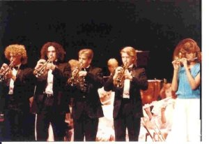 "Cory (4th from left) as a 9th grader playing ""Stars and Stripes Forever"" with the Highland Park Senior High School Concert Band."