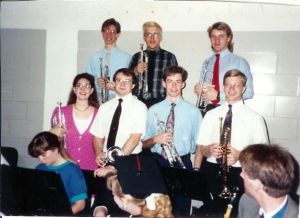 Cory (top row, right) as a college sophomore playing at the commencement ceremony at Central College in Pella, IA.