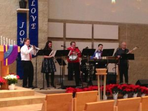 Cory (left) in 2012, playing during Advent with the Dixieland Band at Shepherd of the Hills Lutheran Church in Shoreview.